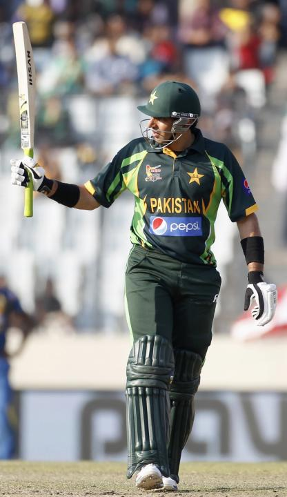 Pakistan's captain Misbah-ul-Haq celebrates after scoring a half century against Sri Lanka during their 2014 Asia Cup final match in Dhaka