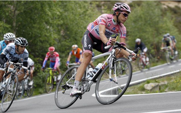 File - In this May 27, 2011 file photo Spain's Alberto Contador, right, leads the pack during the 19th stage of the Giro d'Italia, Tour of Italy cycling race near Macugnaga, Italy.  Sport's highest co
