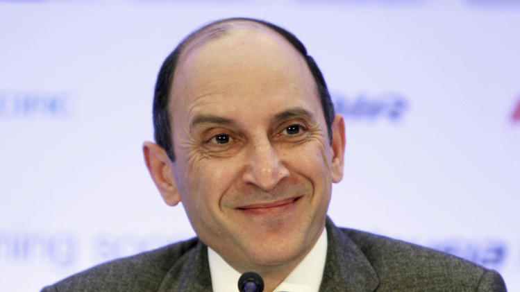 CEO of Qatar Airways Akbar Al Baker smiles during a news conference in New York, Monday, Oct. 8, 2012. Qatar Airways is joining an alliance of airlines including American Airlines, British Airways and nine other carriers that coordinate routes and allow passengers to earn frequent flier miles on each other's flights. (AP Photo/Seth Wenig)