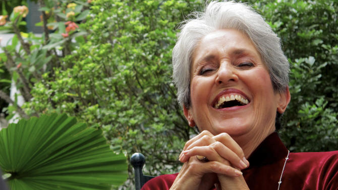 In this April 6, 2013 photo, Joan Baez laughs while speaking to former staff at the Metropole Hanoi in Hanoi, Vietnam.  The folk singer and social activist visited Vietnam recently for the first time since she came to the country in December 1972 as part of an American peace delegation. (AP Photo/Dinh Hau)