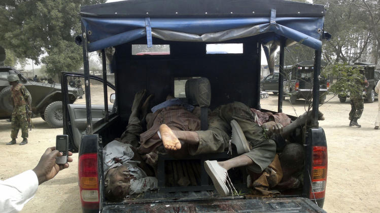 FILE: In this file photo taken Wednesday, March. 21, 2012. bodies of suspected members of the radical Islamist sect Boko Haram, are seen in the pick up van at the  Bukavu Barracks in, Nigeria, Suspected members of Boko Haram attacked a police headquarters, the home of a senior police officer and set fire to a nearby bank, in Tunun Wade, Nigeria, also stealing police uniforms, and weapons before clashing with the military during their escape, Brig. Gen. Iliyasu Abba told journalists during a briefing Wednesday. Now, Boko Haram seems to be growing ever-stronger, killing more people than ever before and slowly internationalizing their outlook, a possible danger for the rest of West Africa. More than 770 people have been killed in Boko Haram attacks so far this year, according to an Associated Press count, making 2012 the worst year of violence attributed to the group (AP Photos/Salisu Rabiu, File)