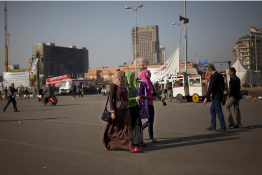 Egyptians walk around Tahrir Square in Cairo, Egypt, Monday, Dec. 5, 2011. A runoff Monday for Egypt's first-round parliamentary elections exposed tensions between competing Islamist parties that have so far dominated the vote.(AP Photo/Bernat Armangue)