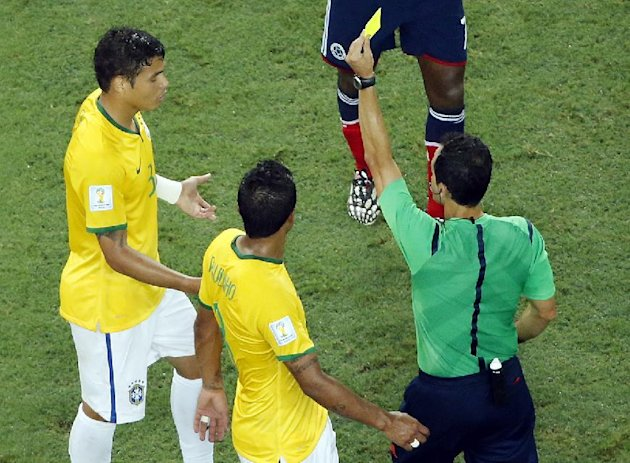 Brazil's Thiago Silva gets a yellow card during the World Cup quarterfinal soccer match between Brazil and Colombia at the Arena Castelao in Fortaleza...