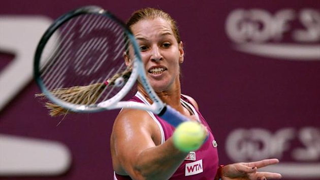 Slovakia's Dominika Cibulkova hits a return to her opponent Netherland's Kiki Bertens during the 21st edition of the Paris WTA Open (AFP)