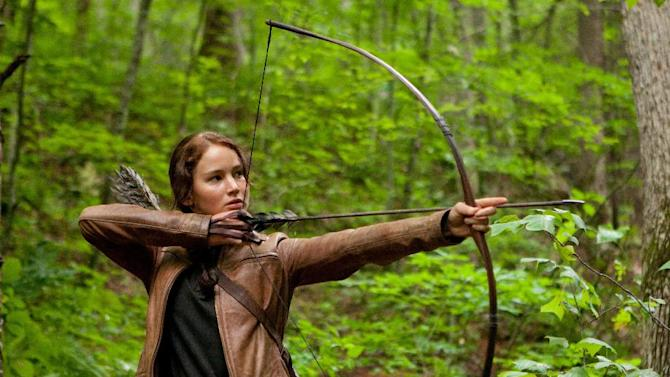 """FILE - In this image released by Lionsgate, Jennifer Lawrence portrays Katniss Everdeen in a scene from """"The Hunger Games,"""" opening on Friday, March 23, 2012.  Lionsgate announced today that """"The Hunger Games: Mockingjay,"""" Part 1 will be released on November 21, 2014, and Part 2, will be released on November 20, 2015. (AP Photo/Lionsgate, Murray Close, File)"""