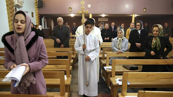Iranian Christians attend Mass on Christmas Day at the Saint Mary Chaldean-Assyrian Catholic church in Tehran, Iran, Thursday, Dec. 25, 2014. Iran's minority group of Christians are celebrating Christmas and preparing for the new year. According to official figures, around 120,000 Christians live in Iran, mostly in central and northwestern parts of the country. (AP Photo/Ebrahim Noroozi)