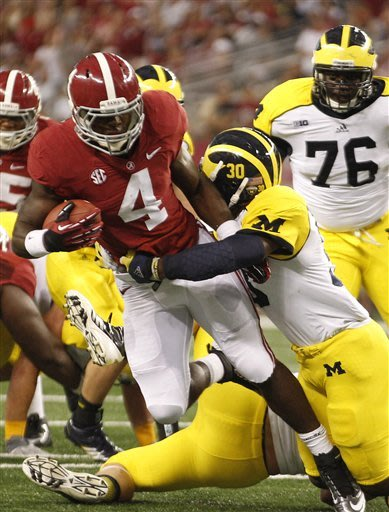 Alabama rather be title contender than defender