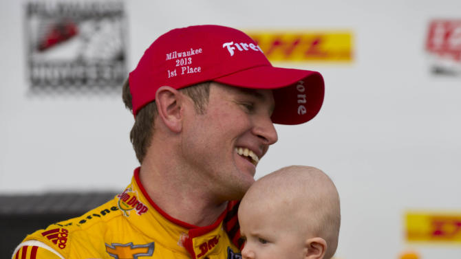 Ryan Hunter-Reay celebrates in victory circle with his son, Ryden, after an IndyCar Series auto race at the Milwaukee Mile in West Allis, Wis., Saturday, June 15, 2013. (AP Photo/Jeffrey Phelps)