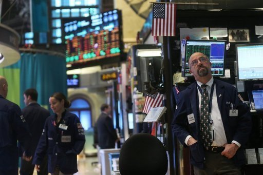 <p>Traders work on the floor of the New York Stock Exchange on December 12, 2012. InterContinentalExchange (ICE) would have to pay NYSE Euronext $750 million if their merger is blocked by regulatory or competition authorities, according to an SEC filing published.</p>