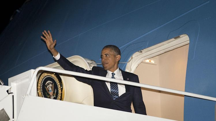 President Barack Obama waves as he boards Air Force One before his departure, Tuesday, Sept. 3, 2013 at Andrews Air Force Base, Md. Obama is traveling to Sweden and later to the G-20 Summit in St. Peterburg, Russia. (AP Photo/Pablo Martinez Monsivais)