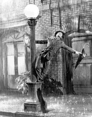 "FILE - In this undated file photo, Gene Kelly performs in the 1952 film ""Singin' in the Rain."" The grey wool suit Kelly wore in the movie is going up for auction after being kept in a closet by a memorabilia collector for more than four decades. (AP Photo/File)"