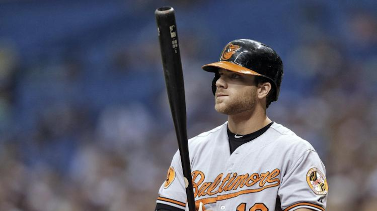 In this Sept. 23, 2013, photo, Baltimore Orioles' Chris Davis bats during a baseball game against the Tampa Bay Rays in St. Petersburg, Fla. Davis and the Orioles agreed to a $10.35 million deal Friday, Jan. 17, 2014
