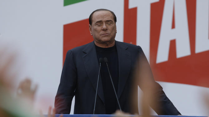 "Silvio Berlusconi talks to his supporters during a demonstration organized by PDL party for its leader, in front of his residence in Rome, Italy, Sunday, Aug. 4, 2013. Italy's former premier, Silvio Berlusconi, for the first time in decades of criminal prosecutions related to his media empire was definitively convicted of tax fraud and sentenced to prison by the nation's highest court. Judge Antonio Esposito, in reading the court's decision Thursday, declared Berlusconi's conviction and four-year prison term ""irrevocable."" He also ordered another court to review the length of a ban on public office — the most incendiary element of the conviction because it threatens to interrupt, if not end, Berlusconi's political career. (AP Photo/Andrew Medichini)"