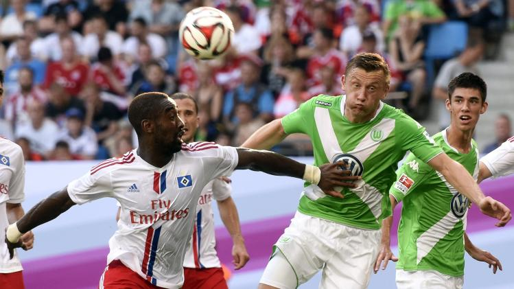 Hamburg SV's Djourou and VfL Wolfsburg's Olic fight for the ball during their German Telekom Cup soccer match in Hamburg