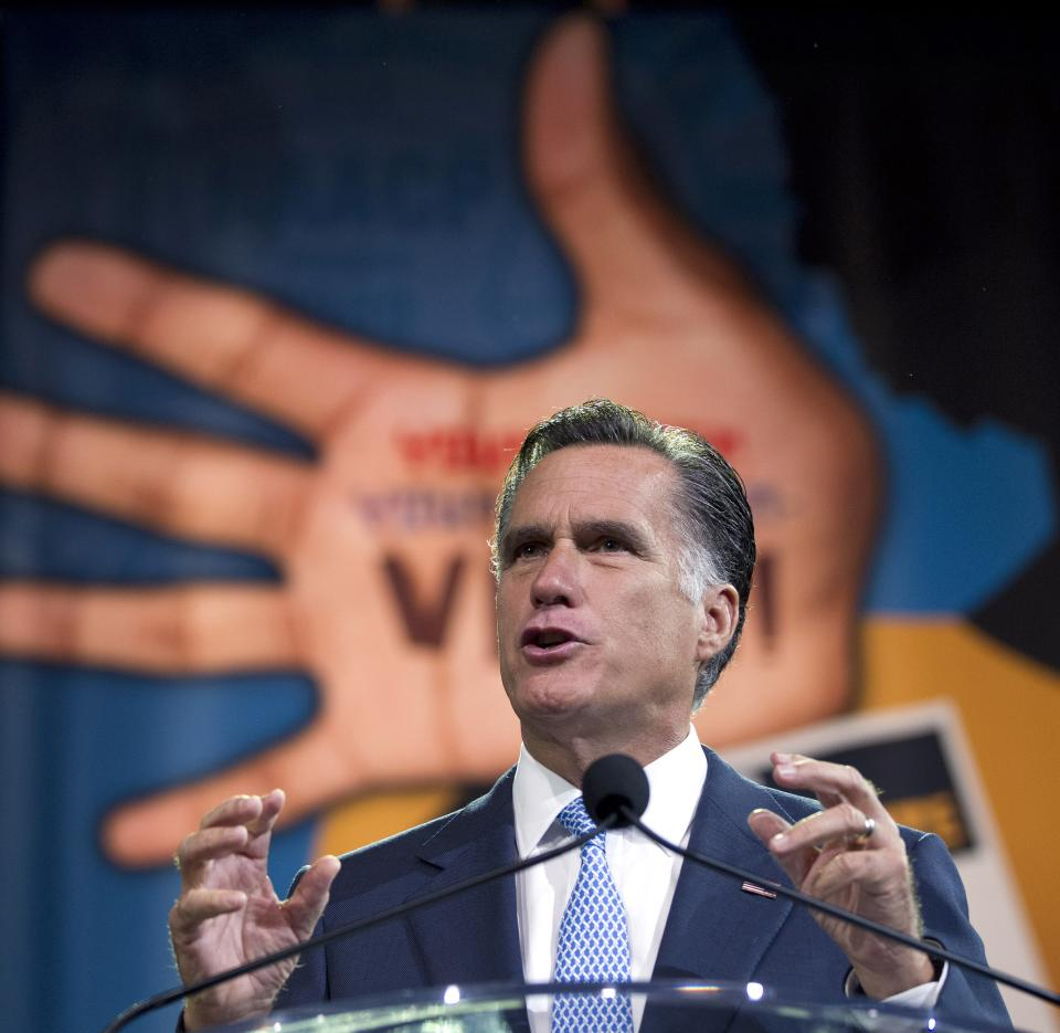 Republican presidential candidate, former Massachusetts Gov. Mitt Romney gestures during a speech to the NAACP annual convention, Wednesday, July 11, 2012, in Houston, Texas.  (AP Photo/Evan Vucci)