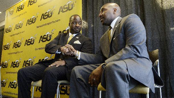 Brian Jenkins, left, new head coach for the Alabama State University NCAA college football team shakes hands with Interim Athletic Director Melvin Hines during a news conference to introduce Jenkins on Wednesday, Dec. 17, 2014 at ASU Stadium in Montgomery, Ala. Jenkins has coached the last five seasons at Bethune-Cookman University. (AP Photo/Montgomery Advertiser, Mickey Welsh)