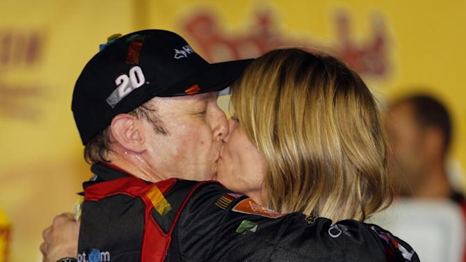 Matt Kenseth kisses his wife, Katie, in Victory Lane after winning the NASCAR Sprint Cup series auto race at Darlington Raceway, Saturday, May 11, 2013, in Darlington, S.C.  (AP Photo/Mic Smith)