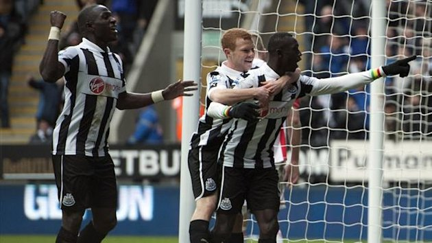 Newcastle United's Papiss Cisse celebrates scoring his side's winning goal of the game (PA Photos)