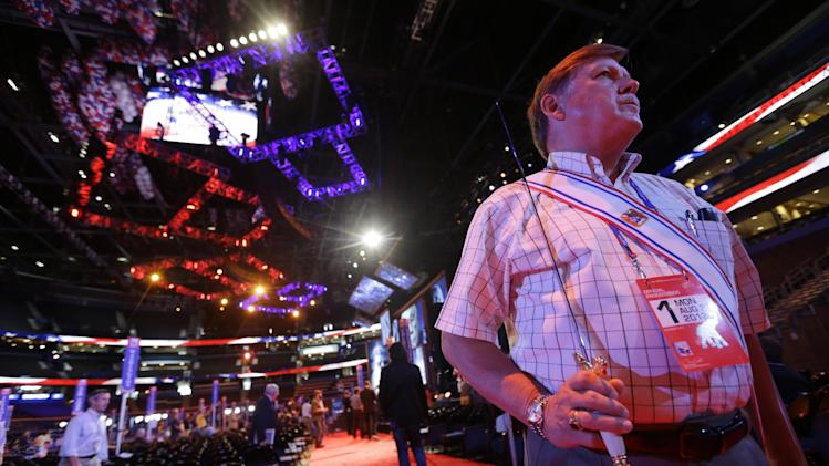 Knights of Columbus honor guard Dennis Stoddard from Jacksonville, Fla. rehearses on the floor of the Republican National Convention inside of the Tampa Bay Times Forum in Tampa, Fla., on Sunday, Aug. 26, 2012. (AP Photo/David Goldman)