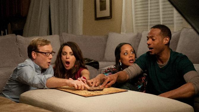 """This film image released by Open Road Films shows, from left, Andrew Daly, Marlene Forte, Essence Atkins, and Marlon Wayans in a scene from """"A Haunted House."""" (AP Photo/Open Road Films, Will McGarry)"""