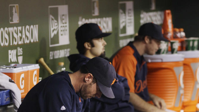 Detroit Tigers' Justin Verlander reacts in the dugout during the ninth inning against the Texas Rangers at Game 6 of baseball's American League championship series Saturday, Oct. 15, 2011, in Arlington, Texas. Texas won 15-5 and moves on to the World Series.(AP Photo/Paul Sancya)