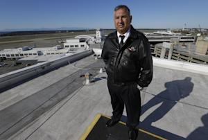 Capt. Oscar Vela stands on a rooftop at Seattle-Tacoma…