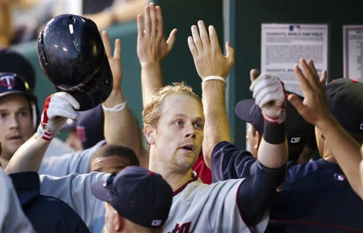 Morneau powers Twins to 10-7 win over Royals
