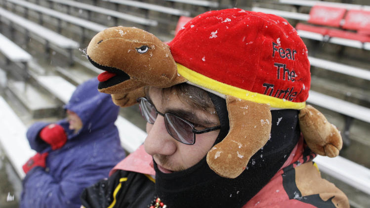 William Handelman, foreground, and his aunt Beth, rear, bundle up as snow falls in the stands before an NCAA college football game between Boston College and Maryland in College Park, Md., on Saturday, Oct. 29, 2011. (AP Photo/Patrick Semansky)