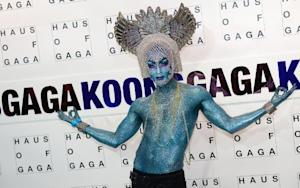 A fan of US singer Lady Gaga walks the red carpet during…
