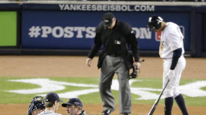 Detroit Tigers starting pitcher Doug Fister  speaks with pitching coach Jeff Jones, right, and catcher Gerald Laird as New York Yankees Alex Rodriguez waits to bat in the first inning during Game 1 of the American League championship series Saturday, Oct. 13, 2012, in New York. (AP Photo/Charlie Riedel)