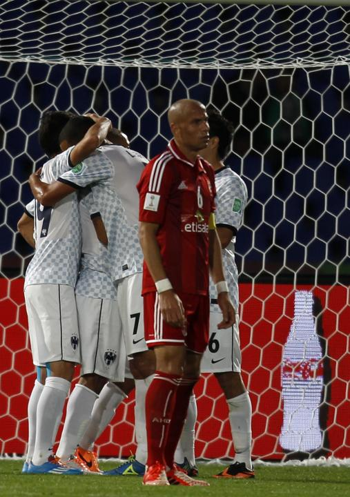 Wael Gomaa, captain of Egypt's Al Ahly, reacts after Cesar Delgado of Mexico's Monterrey scored the fifth goal during their 2013 FIFA Club World Cup football match for the fifth place in Marra