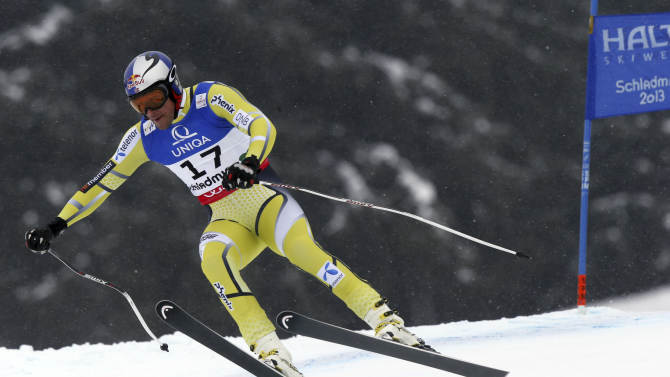 Norway's Aksel Lund Svindal is airborne as he speeds down the course during the men's downhill, at the Alpine skiing world championships in Schladming, Austria, Saturday, Feb.9, 2013. (AP Photo/Alessandro Trovati)