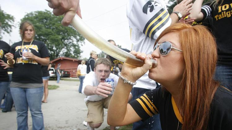 In this Sept. 6, 2008, photo University of Iowa student Caryn Vaneck drinks from a beer bong while tailgating before a football game in Iowa City, Iowa. The Princeton Review named the University of Iowa as the nations's best party school Monday, Aug. 5, 2013, on a list determined by 126,000 students in a nationwide survey. (AP Photo/Iowa City Press Citizen, Matthew Holst)