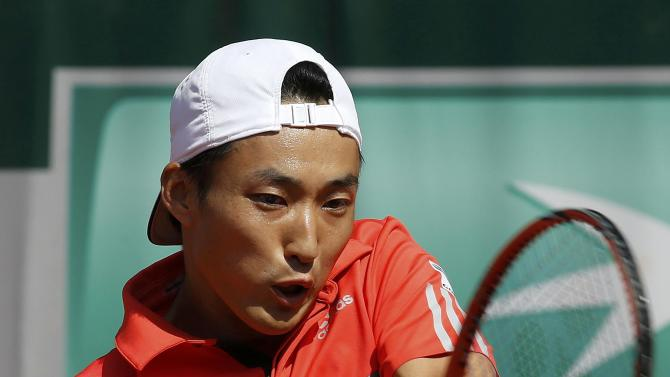 Go Soeda of Japan plays a shot to Philipp Kohlschreiber of Germany during their men's singles match at the French Open tennis tournament at the Roland Garros stadium in Paris