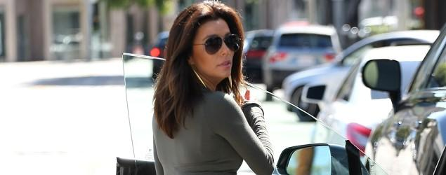 Eva Longoria sizzles in tight grey dress