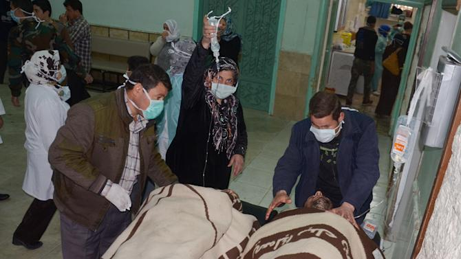 """In this photo released by the Syrian official news agency SANA, Syrian victims who suffered an alleged chemical attack at Khan al-Assal village according to SANA, are covered by blankets as they receive treatment, at a hospital in Aleppo, Syria, Tuesday March 19, 2013. Syria's information minister says a chemical weapon fired by rebels on a village in the north of the country is the """"first act"""" by the opposition interim government announced in Istanbul. He says 16 people were killed and 86 wounded in the attack. Rebels have denied the accusation and say regime forces fired the weapon. (AP Photo/SANA)"""