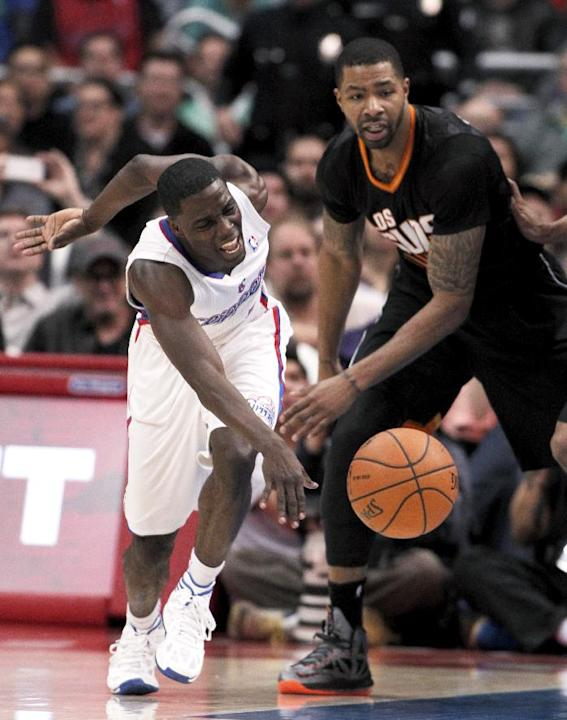 Phoenix Suns forward Marcus Morris, right, knocks the ball away from Los Angeles Clippers guard Darren Collison, left, during the second half of an NBA basketball game Monday, March 10, 2014, in Los A