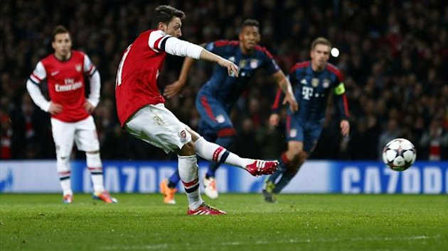 Arsenal's Mesut Ozil misses a penalty kick against Bayern Munich (Reuters)