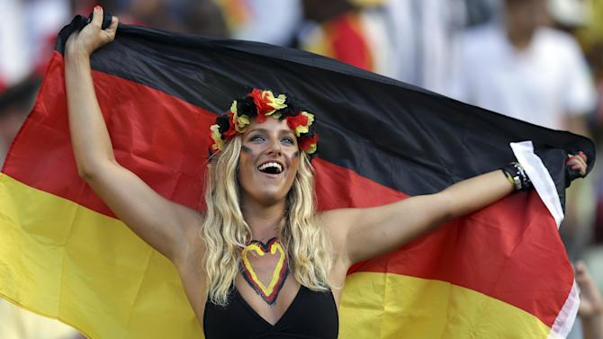 A German supporter cheers for her national team before the group G World Cup soccer match between Germany and Ghana at the Arena Castelao in Fortaleza, Brazil, Saturday, June 21, 2014