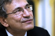 Turkish writer Orhan Pamuk ahead of receiving the French Legion of Honor medal in Paris on October 29, 2012. A debut novel and a work by a Nobel laureate were among five books shortlisted for Asia's most prestigious literary prize on Wednesday, with entries across the region from Turkey to Japan