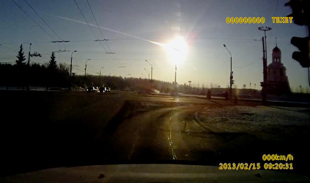 In this frame grab made from a video done with a dashboard camera a meteor streaks through the sky over Chelyabinsk, about 1500 kilometers (930 miles) east of Moscow,  Friday, Feb. 15, 2013. A meteor