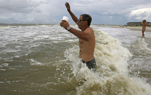 Robert Gibbs, from Newton, Miss., keeps his footing as he is hit by a wave in the surf Thursday, Sept. 1, 2011, in Dauphin Island, Ala. Forecasters have issued tropical storm warnings for the U.S. Gulf coast from Mississippi to Texas as a depression has organized in the Gulf of Mexico. (AP Photo/Mobile Press-Register, G.M. Andrews) NO SALES; MAGS OUT