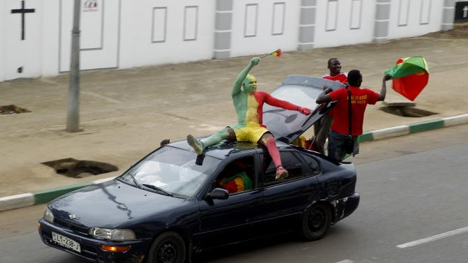 Mali's supporters drive down a streets before the team's 2015 African Cup of Nations soccer match against Guinea in Mongomo