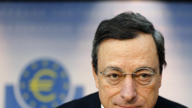 President of European Central Bank, ECB, Mario Draghi waits for the beginning of a news conference in Frankfurt, Germany, Thursday,  Nov. 8, 2012, following a meeting of the ECB governing council. The bank held off cutting interest rates Thursday even though the economy of the 17 countries that use the euro is in desperate need of a lift. It left its key interest rate unchanged at a record low 0.75 percent at its monthly rate-setting meeting in Frankfurt. (AP Photo/Michael Probst)