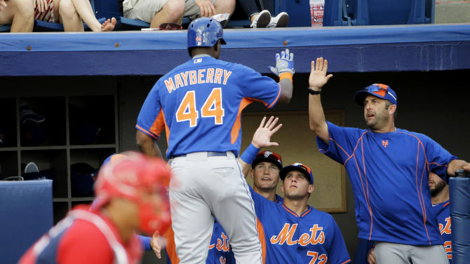 New York Mets' John Mayberry Jr., left, is high-fived by teammates after hitting a home run in the second inning of an exhibition spring training baseball game against the Washington Nationals, Thursday, March 5, 2015, in Viera, Fla. (AP Photo/David Goldman)