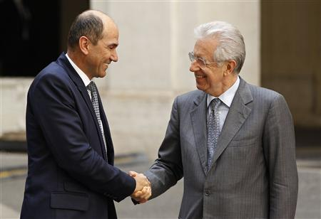 Italian PM Monti shakes hands with his Slovenian counterpart Jansa in Rome