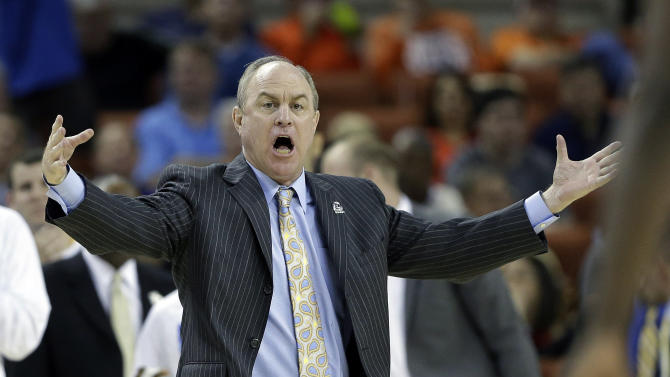 In this Friday, March 22, 2013, photo, UCLA coach Ben Howland talks to his players during the second half of a second-round game of the NCAA college basketball tournament in Austin, Texas. UCLA announced Sunday, March 24, 2013, that the university has fired Ben Howland as basketball coach after 10 seasons that included three Final Four appearances, but culminated with another early-round exit from the NCAA tournament. (AP Photo/Eric Gay)