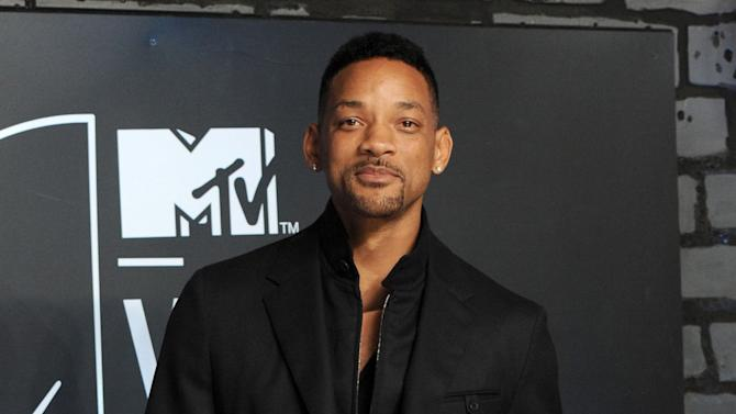 "FILE - This Aug. 25, 2013 file photo shows Will Smith at the MTV Video Music Awards at the Barclays Center in the Brooklyn borough of New York. NBC announced Monday, Feb. 10, 2014, that Will Smith will appear on the Feb. 17 debut of ""The Tonight Show Starring Jimmy Fallon."" U2 will perform. Justin Timberlake will close out the week, which will also include appearances from Michelle Obama, Will Ferrell, Bradley Cooper, Kristen Wiig and Jerry Seinfeld. Lady Gaga, Arcade Fire and Tim McGraw will also perform during the week. (Photo by Evan Agostini/Invision/AP, File)"