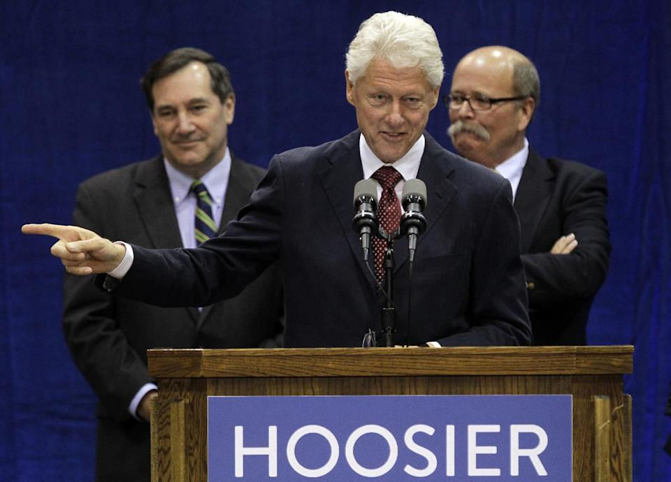 "Former President Bill Clinton speaks at a ""Hoosier Common Sense"" rally for Indiana Democratic Senate candidate Joe Donnelly, left,  and Democratic Indiana gubernatorial candidate John Gregg, right, in Indianapolis, Friday, Oct. 12, 2012.  (AP Photo/Michael Conroy)"