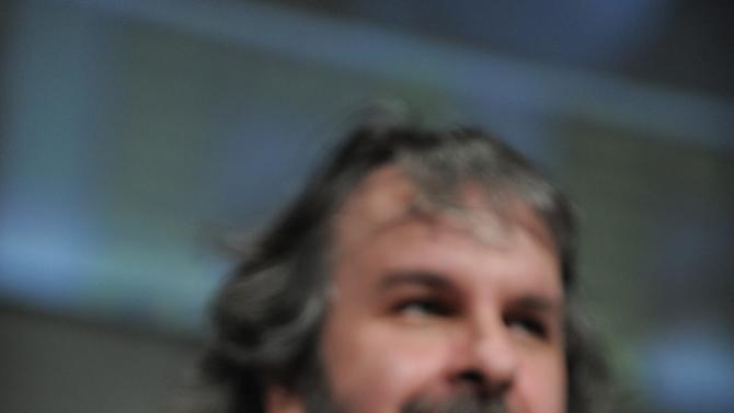"""Peter Jackson films the audience at the """"The Hobbit: An Unexpected Journey"""" panel 2012 Comic Con on Saturday, July 14, 2012 in San Diego, Calif. (Photo by Jordan Strauss/Invision/AP)"""